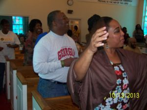 Minister waving hands in worship