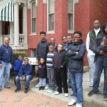 boys and leaders standing outside Maggie Walker's house