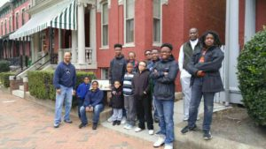 Young Men In Jesus standing outside the Maggie Walker house museum